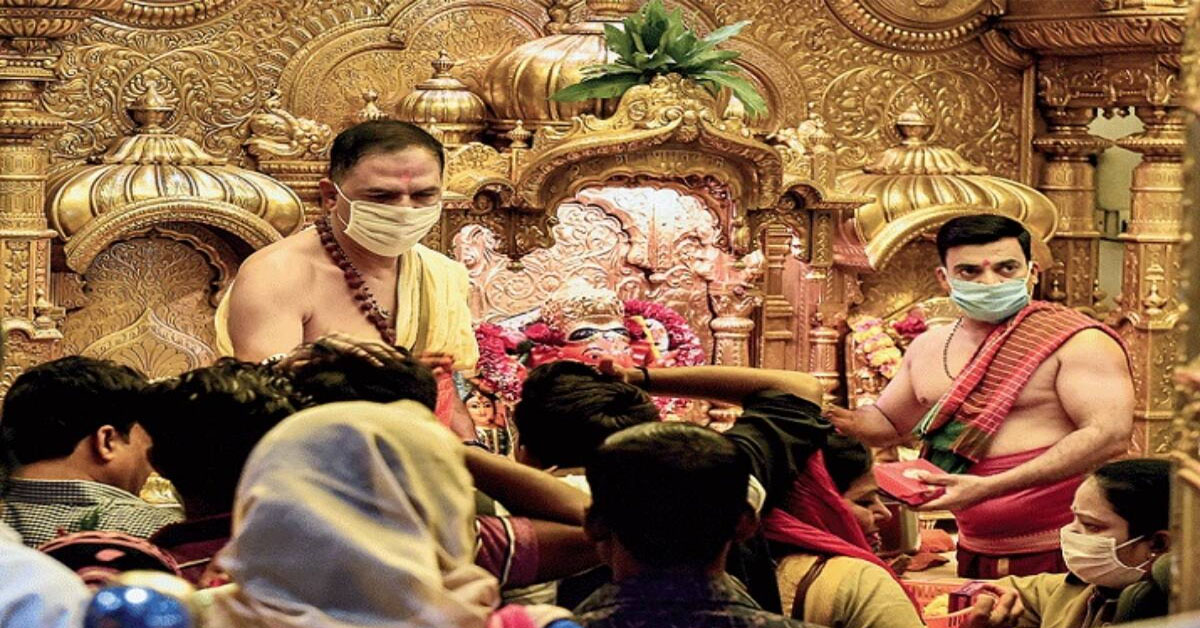 Places of worship reopen in Maharashtra; devotees visit temples