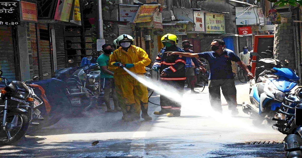 In Tamilnadu Motorbikes with disinfectant sprayers to sanitise alleys